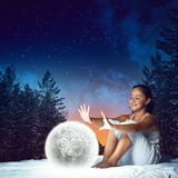 Girl dreaming before sleep Royalty Free Stock Photography