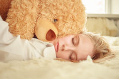 Girl dreaming with teddy bear Royalty Free Stock Photo