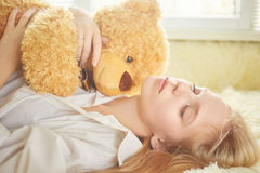Girl dreaming with teddy bear Stock Photos