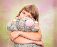 Girl dreaming with toy cat. Girl dreaming with grey plush toy cat Stock Photos