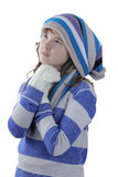 Girl dreaming in winter clothing Stock Photography