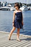Girl dreams bear the pier Stock Photos