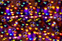 Girl dreams of hope. The background to the day of Valentine hearts composed of lights and bubbles Royalty Free Stock Photography