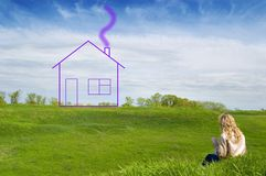Girl dreams of the house. Girl in the field dreams about the house Royalty Free Stock Photo