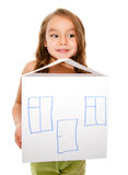 Girl dreams of a new home. Close up of a girl holding a house model isolated on white Royalty Free Stock Image
