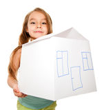 Girl dreams of a new home. Close up of a girl holding a house model isolated on white Royalty Free Stock Images