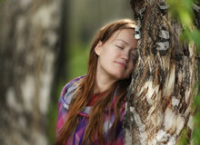 Girl dreams in the wood Royalty Free Stock Photography