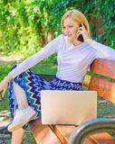 Girl dreamy takes advantage of online shopping. Girl sit bench with notebook call phone. Save your time with shopping. Online. Shopping online. Woman laptop in stock photo