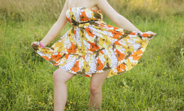 Girl in a dress Stock Images