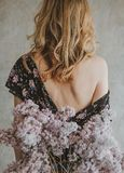 Girl dress back bare shoulder bouquet lilacs stock photos