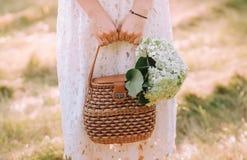 Girl dress bag hold flowers bouquet white stock image