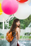 Girl in dress with balloons royalty free stock image