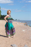 Girl in dress on the beach Royalty Free Stock Image