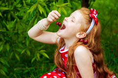 Girl in a  dress in cherry garden Royalty Free Stock Photography