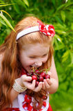Girl in a  dress in cherry garden Stock Photo