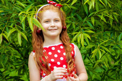 Girl in a  dress in cherry garden Royalty Free Stock Image