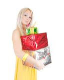 Girl in dress with coloured present boxes Stock Image