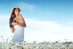 Girl in dress on the daisy flowers field Stock Photography