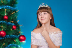 The girl in a dress with a diadem on the head costs at a beautif Royalty Free Stock Image