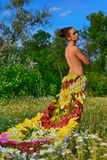 Girl in the dress of the firebird of flowers Royalty Free Stock Images