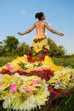 Girl in the dress of the firebird of flowers Royalty Free Stock Photography