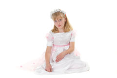 Girl in a dress for first communion Stock Photos
