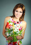 Girl in dress with flowers basket in studio Stock Photos