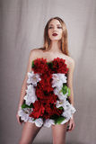 Girl in dress from flowers royalty free stock photo