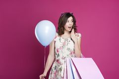 Girl in dress with gift bags and balloon royalty free stock images