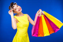 Girl in a dress and glasses with packages Royalty Free Stock Images