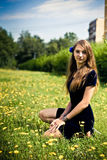 Girl dress in the grass with dandelions Stock Images