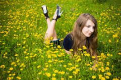 Girl dress in the grass with dandelions. Cute girl dress in the grass with dandelions Royalty Free Stock Photos