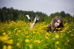 Girl dress in the grass with dandelions. Cute girl dress in the grass with dandelions Stock Images
