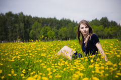 Girl dress in the grass with dandelions Stock Photo