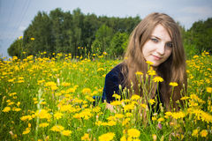 Girl dress in the grass with dandelions Royalty Free Stock Photos