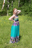 Girl in dress on the grass Stock Photography