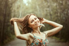 Girl in dress is happy. Beautiful girl in dress is happy in his arms Stock Photography