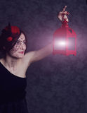 Girl in a dress and hat with lantern Royalty Free Stock Image