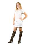 Girl in  dress and  high boots Royalty Free Stock Image