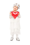 Girl in dress holding a red heart and thinking Royalty Free Stock Images