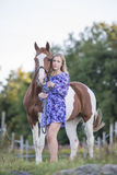 Girl in dress with horse Royalty Free Stock Photo