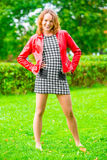 Girl in a dress and jacket posing Royalty Free Stock Photography