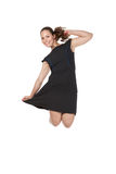 Girl in a dress jumping in studio Royalty Free Stock Photo