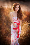 Girl in a dress with long hair Stock Images