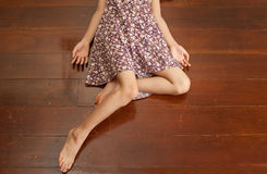 girl in dress lying on brown wooden floor Royalty Free Stock Images