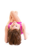 Girl in a dress lying on her back Stock Photos