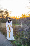 Girl in dress and manner of Nefertiti. In the park at sunset Royalty Free Stock Image