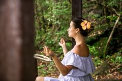 Girl in a dress meditates royalty free stock images