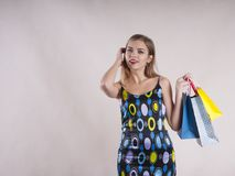 Beautiful girl in a dress  stylish with packages fashionable for purchases studio. Girl in a dress with packages for purchases studio fashionable stylish Royalty Free Stock Photo