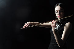 The girl in a dress playing the violin, art, emotions Stock Photos